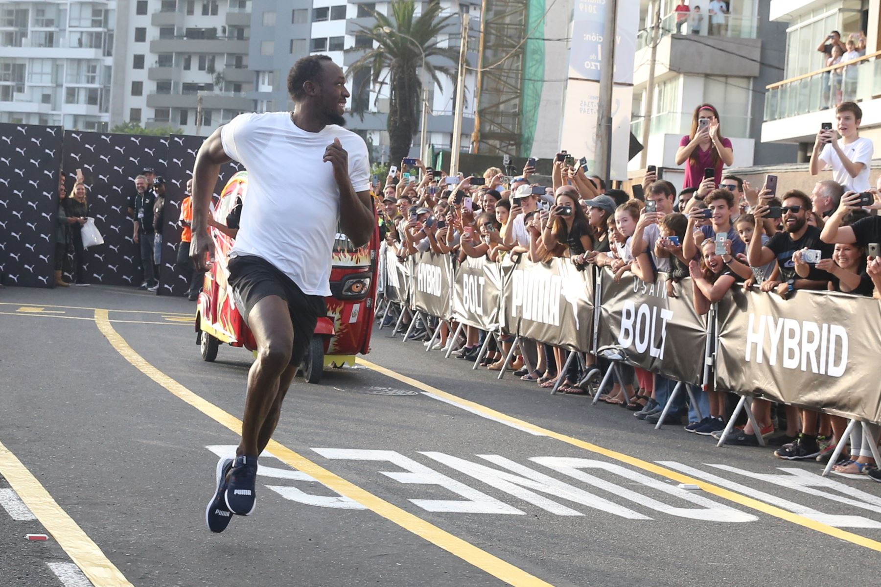 Gold medalist Bolt runs in Peru, beats a mototaxi